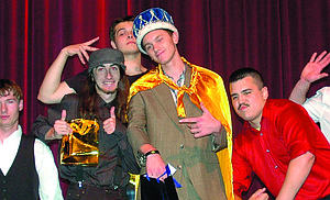 Wearing crown and cape, Story Heath-McKee is surrounded Thursday by his fellow competitors. From left: Sean Crompton, Colton Fitzpatrick, Chad Perry, Tyler Santoyo and Adam Kuatt.