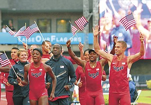 Team USA members  parade around the track in their Nike uniforms after making the team.