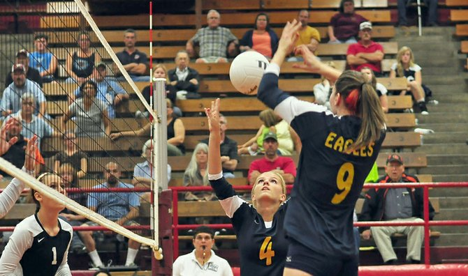 Amanda McCafferty sets the ball to Tabitha Merten Thursday at The Dalles Wahtonka. 