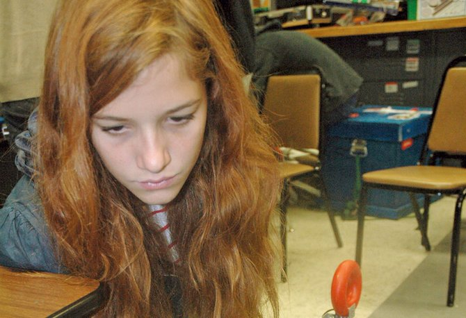 "HRVHS senior Lily Paul checks programming before putting her robot, Jitterbug, through the paces. ""I really like how it's hands-on learning and it's kind of up to you to figure things out,"" said Paul, a third-year robotics student. ""It's a lot of problem solving, and really fun."""