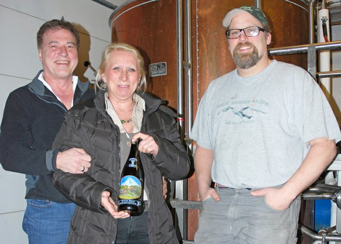 DAVE LOGSDON, left, with partner Judith Bam and brewer Charles Porter in the brewery. Farmhouse Ales are available locally on tap and in bottles.