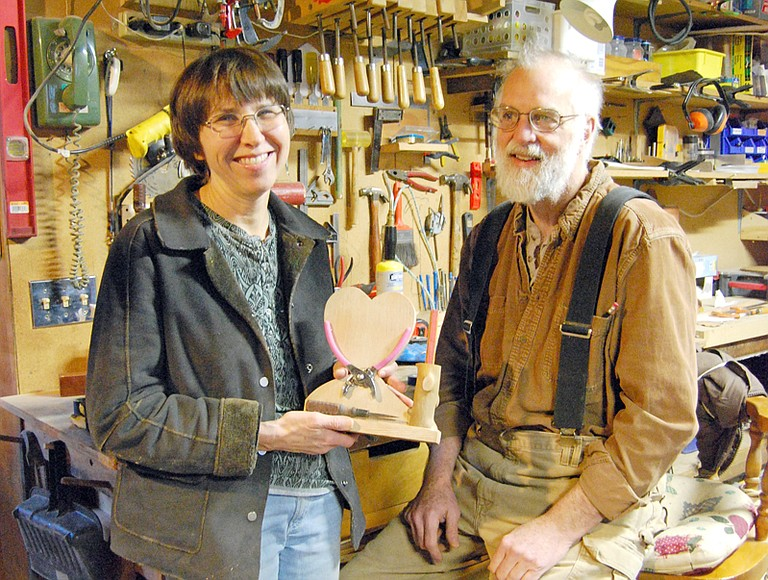 A heart shaped tool caddy brings a smile to Deb Baxter's face as her husband Dan looks on after giving her the early Valentine's gift. The pair has found a life-long bond through shared work, mutual respect and a practical recipe for time spent together.