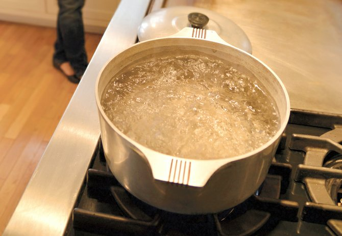 boiling water has become a daily routine, and annoyance, for Sunset Road resident Chris Reitz. About 315 Oak Grove Water District customers have had to boil water for close to three months due to district infrastructure issues. 