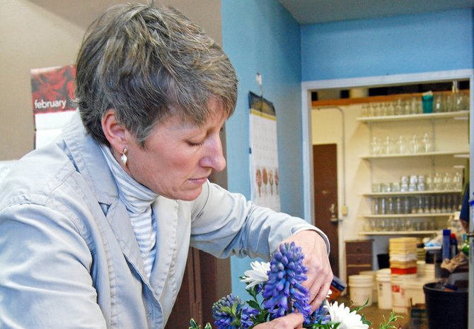 Taking care to add just the right sentiment into every bouquet is Tammy Hall, owner of Tammy's Floral on the Heights.