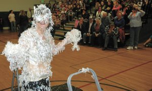 Feathered friend: Parkdale Principal Kim Vogel stands covered in syrup and feathers in Friday's reward assembly.