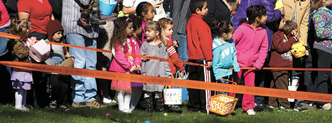 Crowds of children and adults wait (somewhat) patiently for the countdown at the 2013 Community Egg Hunt, made possible by volunteers from the Columbia Gorge Fellowship of Churches and donations from local businesses and individuals. More than 7,000 eggs were filled and hidden and each child received a treat-filled goodie bag. Occurring simultaneously was the annual Children's Safety Fair, with fire trucks, police cars and information booths all at Jackson Park.