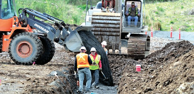 Country club road realignment project is well underway. Workers are seen Monday burying pipe where the new Mt. Adams Avenue road will intersect with Cascade Avenue.