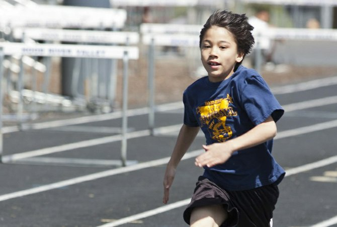 Keone Tactay runs the 100 meters in the boys 9-10 age group at the Hershey's state track and field qualifier in Hood River.