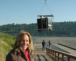 Susie Rowe, new owner of the Sandbar Café, watches at 8:15 a.m. May 9 as the café moves into place at the Hood River waterfront,