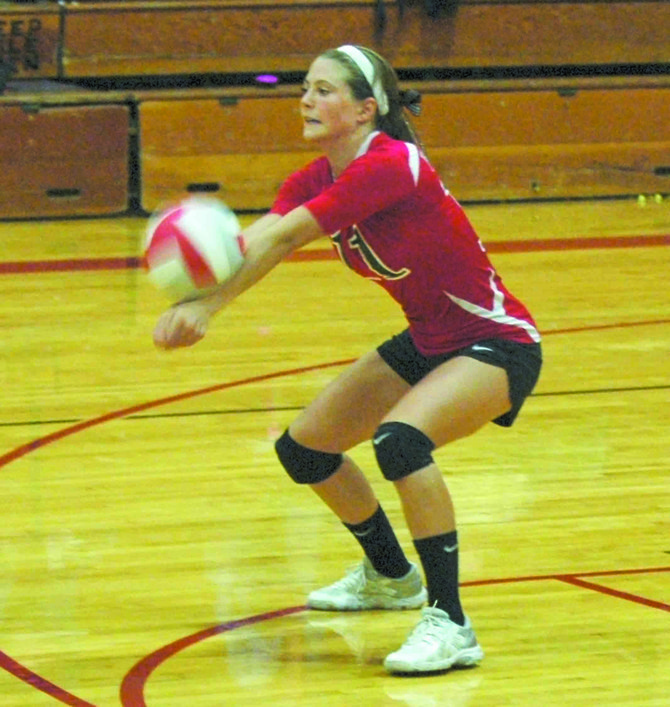 DUFUR'S Kathryn Johnson sends off a return hit in recent volleyball action in Dufur. This weekend, the Rangers went 3-1 at the Heppner Tourney.