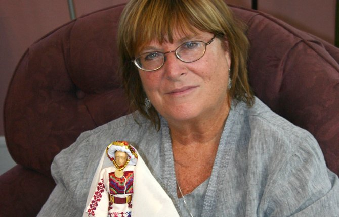 "LOREN MCGRAIL, a United Church of Christ minister who visited The Dalles from Chicago, holds a ""Mariam"" doll based on an actual Palestinian woman. McGrail is working for justice in the country she calls Palestine-Israel.	Neita Cecil photo"