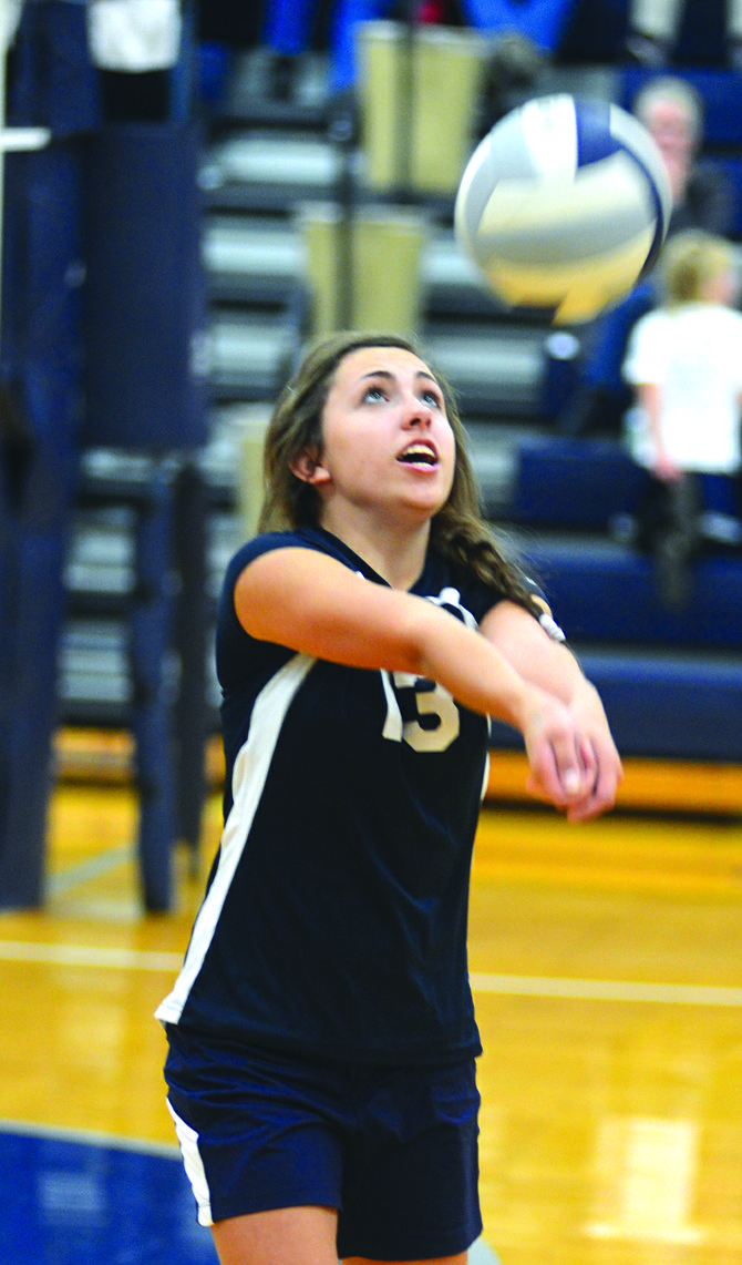 Summit Academy's Rachel Waters plays a free ball over to GHS during Grangeville's Oct. 10 home win (25-12, 25-17, 25-21). Summit's district run will begin at 5:30 p.m. Oct. 19 at LCSC.
