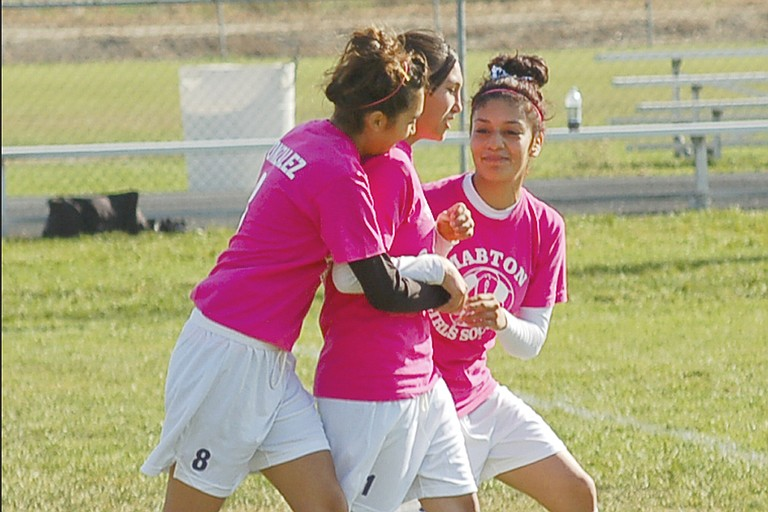 Lady Vikings Sandra Gonzales (left) and Liliana Ocampo (right) congratulate Cristina Gonzalez for scoring the lone goal of Saturday's match against Granger.