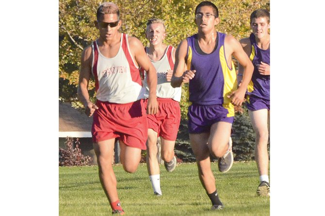 Grandview's JoJo Cisneros and Alex Jaramillo of Mabton (L-R) lead a small four-man pack in yesterday's 5,000-meter race hosted by the Greyhounds. Trailing the two harriers are (L-R) Grandview's Sebastian Raucamp and Mabton's William Ziakawsky.