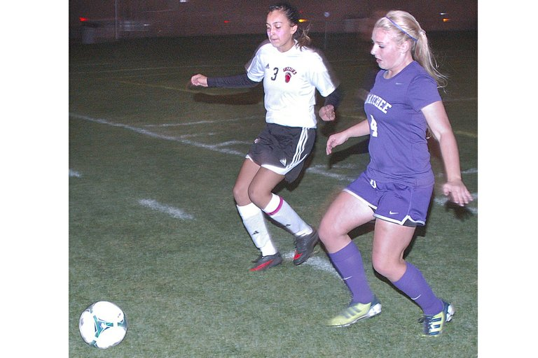 Visiting Wenatchee pounced for two goals in the first five minutes enroute to claiming a 7-2 win over the Lady Grizzly soccer team last night, Thursday. Sunnyside got on the scoreboard with two goals in the final 10 minutes by Susana Arreola and Vianca Madrigal. Pictured are Sunnyside defender Jessica Mendoza (L) hustling after a loose ball as Wenatchee's Emily Rader also gives chase. The Sunnyside High School girls soccer team closes out the regular season next Tuesday, Oct. 29, at Eastmont. The SHS Lady Grizzlies will host a loser-out playoff match against Kennewick on Saturday, Nov. 2, at noon.