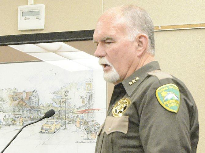 Yakima County Sheriff Ken Irwin speaks to Yakima County commissioners yesterday during a public hearing to discuss the current six-month moratorium prohibiting the sales, production and processing of marijuana.