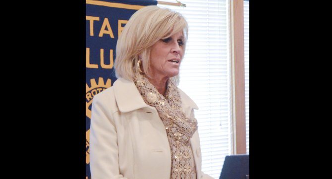 Sunnyside Sun Terrace Assisted Living Center Marketing Director Cheryl Larrick tells Noon Rotary Club members about the services provided to residents at the local facility.