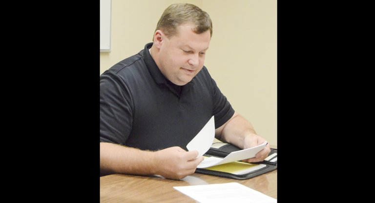 Sunnyside Finance Subcommittee member Jason Raines looks over general fund figures presented at last night's meeting.