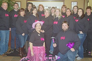 Emma Sandoval (in the pink cowboy hat) and her staff at the Sunnyside branch of Northwest Farm Credit Services model their pink tractor t-shirts worn in support of the company's Pink Tractor Campaign to bring awareness to breast cancer research. The regional company has raised more than $18,000 through the sale of t-shirts, Sandoval said.