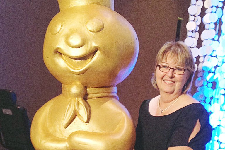 "Kelly Story of Sunnyside was one of 100 finalists from across the country who qualified for an all-expenses-paid trip to Las Vegas to compete at the 46th Pillsbury Bake-Off Contest earlier this week. Here, she takes a moment just prior to Monday evening's awards ceremony to grab a little luck from the Pillsbury Doughboy. Story's Raspberry Apple Stacks didn't win her the grand prize of $1 million, ""…but it was an amazing journey that ended this week with an adventure I've never before experienced,"" she said. This year's $1 million award winner proved to be Glori Spriggs of Henderson, Nev. for her Loaded Potato Pinwheels recipe."
