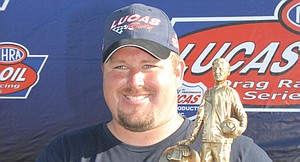Michael Dalrymple of Sunnyside was all smiles in 2009 after winning the 'Wally' for capturing first-place honors in the NHRA's Div. 6 Super Co