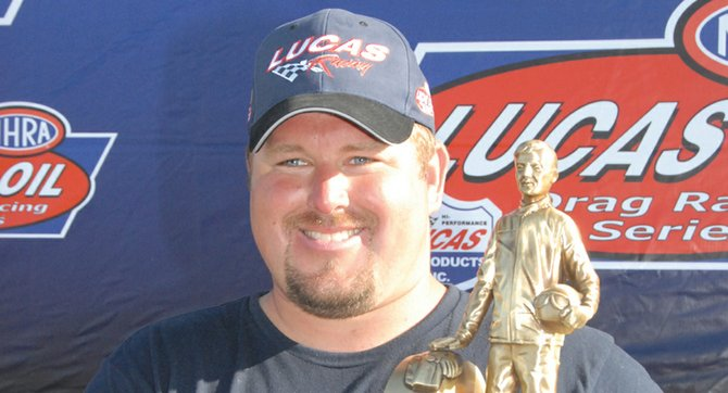 Michael Dalrymple of Sunnyside was all smiles in 2009 after winning the 'Wally' for capturing first-place honors in the NHRA's Div. 6 Super Comp standings. Dalrymple repeated that feat this season, and claimed a top-10 national ranking after a strong performance in Las Vegas earlier this month.