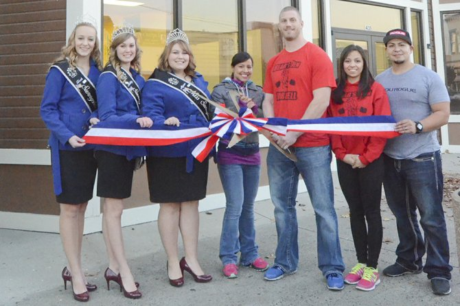 "Present for a ribbon cutting ceremony at Bear's Den Barbell last Friday were (L-R) Miss Sunnyside court members Leah Diddens, Ashley Davis and Alyson Spidle, co-owners Marisol Bazaldua and Andrew ""Bear"" Baranowski, and Catalina and Jorge Bazaldua. The new fitness center is open at 431 S. Sixth St. in Sunnyside."