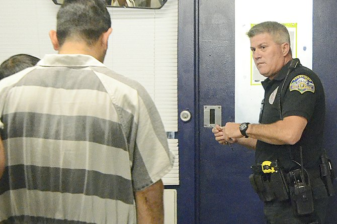 Sunnyside Corrections Officer Jerry Johnston leads a group of inmates to the pods inside the Sunnyside jail.