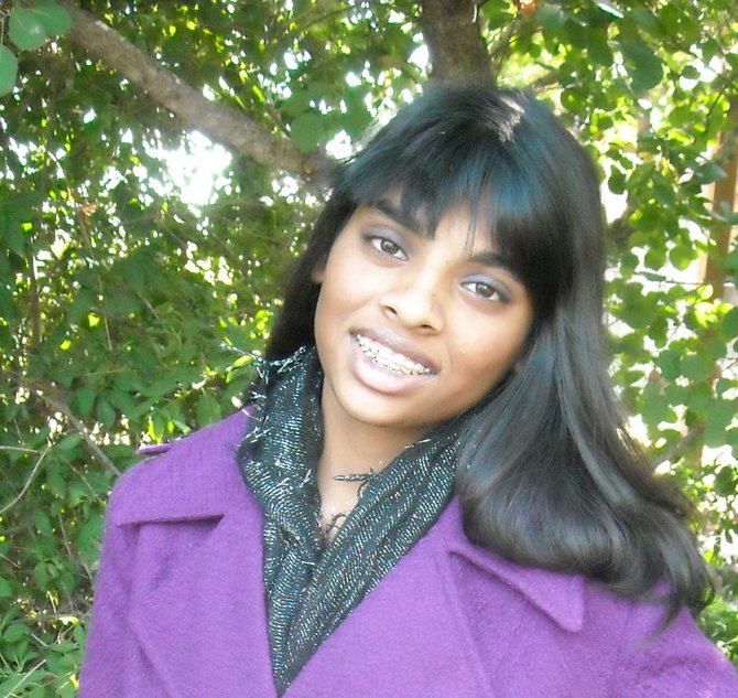 Davi Murphy is shown here modeling her award winning purple wool jacket.