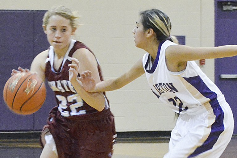 Bickleton High School girls basketball player Hali O'Banion dribbles past a Mabton defender in last night's season opener held on the Mabton High School court.