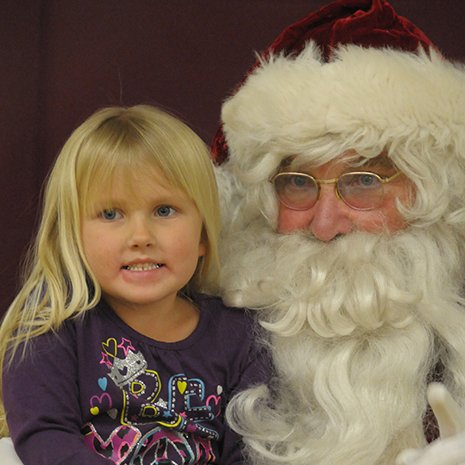Syringa Hospital's Festival of Trees Family Day, held Thursday, Dec. 5, at the Elks Lodge, brought many families in to perform and participate in a variety of activities. Here, Kira Bentley takes a turn with Santa.
