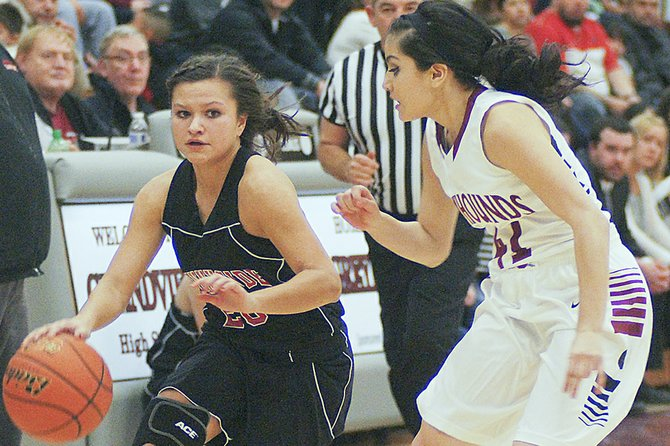 Sunnyside's Selena Rubalcava pushes the ball upcourt with Mayra Mejia of Grandview defending.