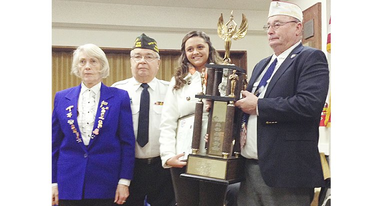 "Joslyn Felicijan of Prosser is the 2013-14 winner of the VFW District 17 Voice of Democracy speech contest. She was presented a $300 check and a traveling trophy for her speech, ""Why I Am Optimistic About Our Nation's Future."" Also pictured are (L-R) VFW District 17 Voice of Democracy chairperson Jean Morris, co-chair Jerry Peltier and VFW District 17 Commander Bill Ingram."