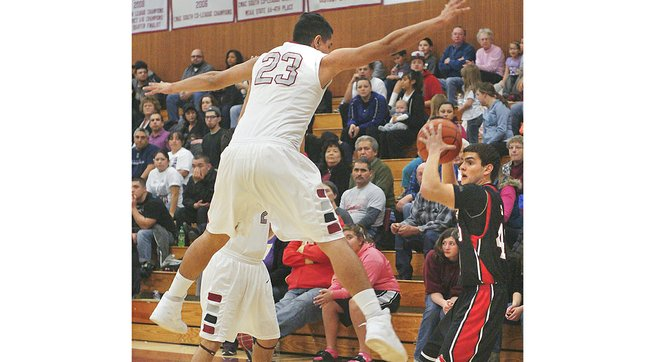 Grandview's Isaiah Gonzalez (23) brings half-court pressure during the Greyhounds' convincing win last night. Gonzalez led Grandview with a double-double, tallying 20 points and 10 rebounds.
