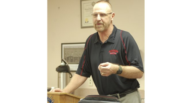 Sunnyside High School Wrestling Coach George Paulus, who was recently inducted into the Washington State Wrestling Coaches Hall of Fame, speaks to Sunnyside Daybreak Rotarians Wednesday morning, explaining the new practices for maintaining athletes' weight.