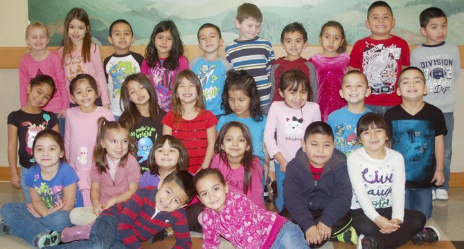 The students of the month for December at Sunnyside's Sun Valley Elementary School, which houses only kindergarten classes, include (front row L-R) Ramon Perez and Kianna Reyes; (second row L-R) Anahi Camacho, Kayla Moreno, Jimena Mondragon, Lanayda Palacios, Francisco Gomez and Delilah Torres; (third row L-R) Serenity Ibarra, Alina Magaña, Maya Starke, Aliyah Starke Brenda Lee Casas, Guadalupe Delacruz, Juan Gutierrez and Dominic Guillen; (back row L-R) Kayla Murray, Kamrynne Medelez-Montelongo, David Driscoll, Ariela Martinez, Alexander Carmona, Evander Chadis, Isaac Sanchez, Alesandra Gonzalez, Alvin Cervantes and Marcos Mendoza. Missing from the photo on the day the top students were recognized is Samuel Gutierrez.