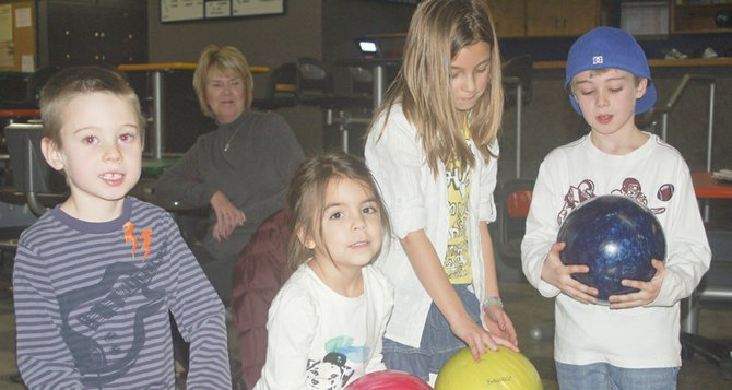 Given a choice between an after Christmas movie and bowling, the Hernandez-Bren cousins chose bowling, said their grandmother, Carolyn Bren of Grandview (in the background). The children visited Sunnyside's Valley Lanes yesterday (Thursday) to try their hand at knocking down pins. Pictured are (L-R) Bryar Bren, Lily Hernandez, Ellie Hernandez and Braxton Bren.