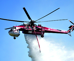2013: A helicopter dumps water on an Aug. 7 fire along State Highway 14.