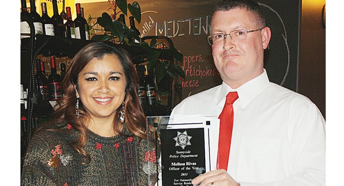 Sunnyside Deputy Police Chief Phil Schenck presents Officer Melissa Rivas with the Officer of the Year Award. Also named officer of the year for 2013 was Matthew Kramer. Rivas was also presented the Eli O'Brien Award.