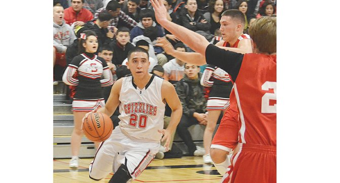 Sunnyside's Isaiah Fernandez drives the ball past Prosser defenders on his way to a team-high 14 points in last Friday's loss to the Mustangs.