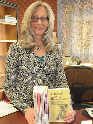 Grangeville Centennial Library's Debbie Urquhart has books ready for the Let's Talk About It series set to begin Jan. 21. Those interested in participating can stop by and pick up books.
