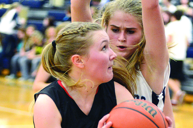 Prairie's Kayla Schumacher looks to shoot despite defensive pressure from Grangeville's Madison Brown. Schumacher scored 20 last Friday night, Jan. 10, but Brown's 12-10 double-double lifted GHS to victory.