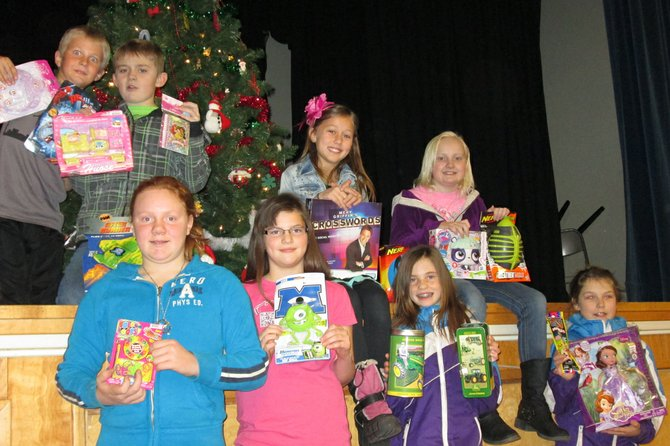 Fourth and fifth grade students at Grangeville Elementary Middle School helped collect toys for the annual Eagles Toys for Tots program. In all, 323 toys were collected. Pictured here are (top, L-R) Ryan Waite, Quincey Daniels, Kaleigh Clark, Dalaney Daniels, Emma Edwards, Kaylee Doughty, Jordan Click and Cheyanne Brown.
