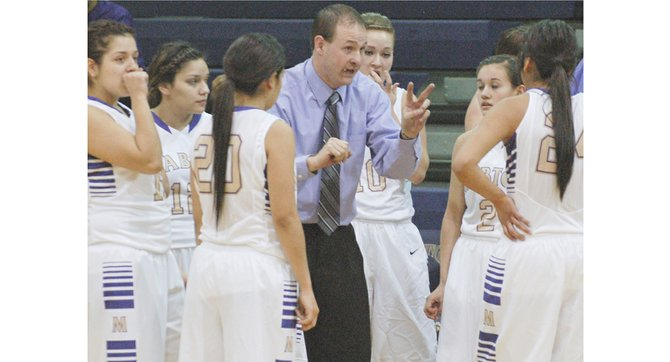 Lady Vikings Coach Chris McCallum stresses the importance of strategy with his team during the final half of last night's game against Highland.