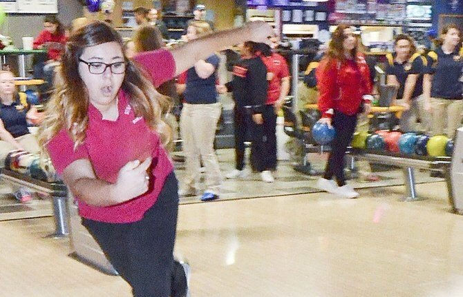 Sunnyside High School's Johanna Chumley lets the ball roll on her way to a 320 in the 300 two-game series yesterday.