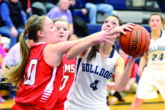 Clearwater Valley sophomore Shalynn Gutzman effectively disrupted GHS senior Chantel Key's shot attempt on this play during Grangeville's 55-26 win Jan. 21. CV bounced back to defeat Troy 48-39 last Thursday night in Kooskia, but fell to Lapwai last Saturday, Jan. 25. The Rams will visit Nezperce at 7:30 p.m. Friday, Jan. 31.
