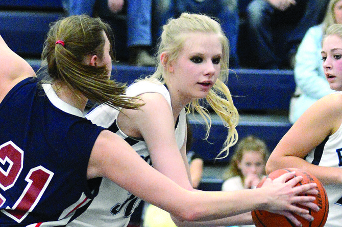 GHS senior Faith Bieler controls a rebound and fends off Coeur d'Alene Charter's Anna Verhaeghe during the second half of Grangeville's 60-18 rout of the Panthers last Saturday, Jan. 25. Grangeville clinched the Central Idaho League title with the win. Grangeville's postseason will begin at the district tournament on Feb. 8 at Troy.