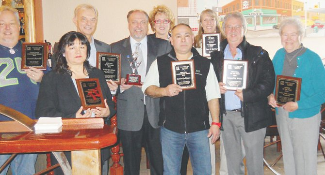 Award recipients during the Yakima Valley Association of Realtors luncheon last week are (front L-R) Gina Gamboa, Javier Rodriguez, Kenneth Nelson and Sister Mary Rita Rohde; (back L-R) Dan Churchill, Larry Goodman, Wayne Langford, Lola Franklin and Laura Ripplinger. Not pictured: Holly Castle.