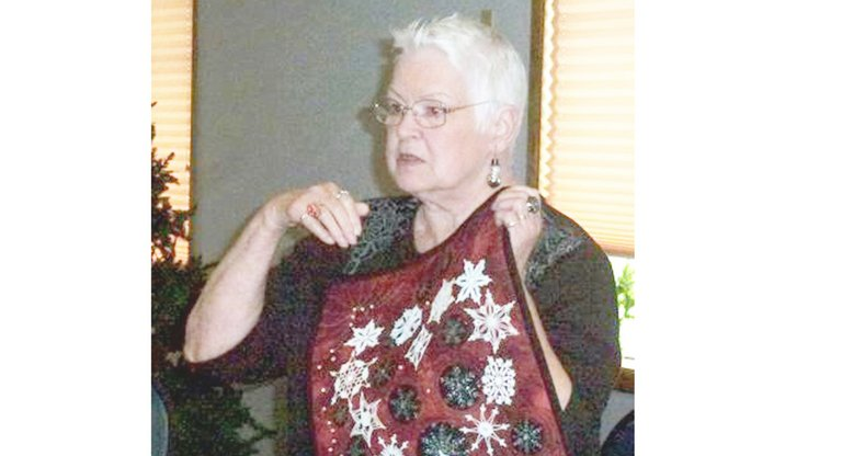 "Sandra Smart of College Place displays a small wall quilt, which she made using hand crocheted snowflakes. The wall quilt, entitled ""Remembering Emily,"" is a sample of the work often shared at Horizon Quilters Unlimited of Yakima Valley meetings. The group will next meet Tuesday, Feb. 11, in the Immanuel Lutheran Church hall, 300 S. Euclid Rd., Grandview. A social hour will be held at 9 a.m., followed by the meeting at 9:30 a.m. A free pattern of the month will be given out, and time will be given for show and tell projects. There will also be a presentation by Mona Margetts of Prosser. She will be demonstrating how to make a square yo yo quilt. A potluck lunch is also planned."