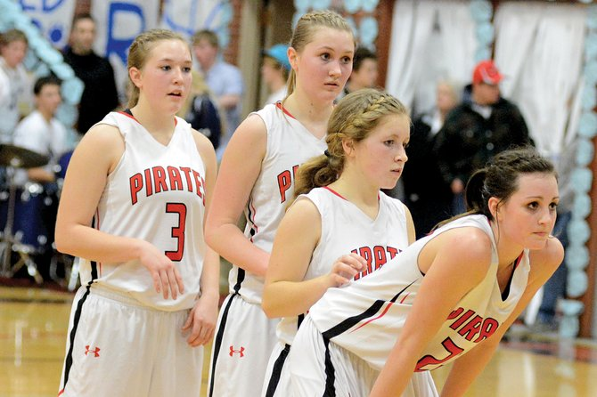 After settling in with Prairie, having transferred from Kamiah, Pirates senior Kyndahl Ulmer (right) has helped make the Pirates a force to be reckoned with one year after helping carry a stacked Kubs team to the 1A state championship. Her fellow seniors Keely Schmidt (left), Kayla Schumacher (second from left), Nicole Wemhoff (second from right), Leah Holthaus (not pictured) and Sky Wilson (not pictured) finished the regular season 17-3 and tied Lapwai for the best record in the Whitepine League. PHS is seeded second in the district tournament on a tiebreaker draw, and is set to play at 7:30 p.m. on Saturday, Feb. 8, against an opponent to be determined.